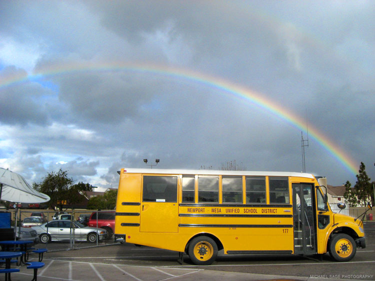 Bus with rainbow in the sky